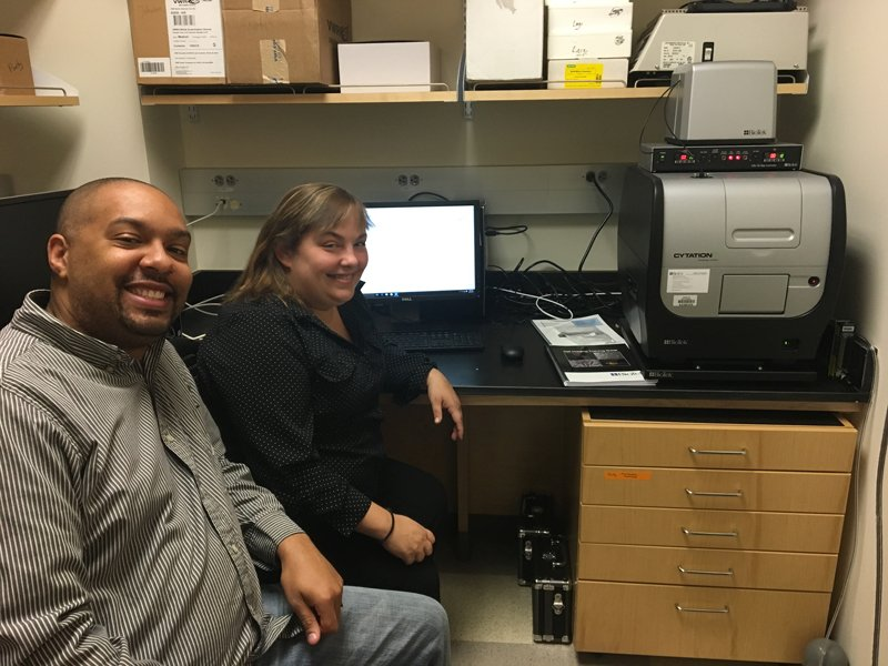Dr. Johnson (left) with Miranda Neubert (right) in the lab with BioTek's Cytation 5.